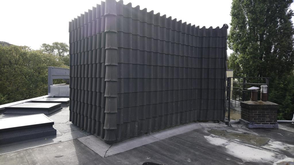 aan-de-voorkant-en-de-zijkant-bekleding-met-dakpannen